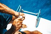 Elderly Man On A Yacht Holding White Sea Shellfish. Beautiful View From A Yacht At Blue Color Seawar poster