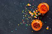 Halloween Background With Halloween Symbols Sweet Candy Corn, Colorful Confetti And Pumpkin Bucket F poster