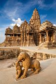 stock photo of mahadev  - King and lion fight statue and Kandariya Mahadev temple - JPG