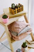 Several Warm Sweaters On A Wooden Shelf On A Light Background. Autumn And Winter Clothes. Small Plan poster