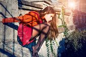 Pretty Autumn Woman In Skirt And Stockings Sit Stairs Architecture Background. Fashion Concept. Yout poster
