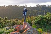 stock photo of naturalist  - Birdwatcher observing birds near Okarito New Zealand - JPG