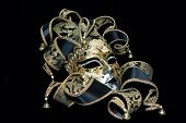 image of masquerade mask  - Ornate venetian mask lying on black background - JPG