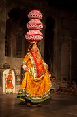 UDAIPUR, INDIA - NOVEMBER 24: Bhavai - famous folk dance of Rajasthan. Performer balances number pot