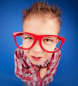 foto of misbehaving  - Funny five years old boy with expressive face - JPG