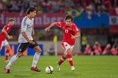 VIENNA,  AUSTRIA - SEPTEMBER 11 Sami Khedira (#6 Germany) and Veli Kavlak (#19 Austria) fight for th