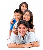 picture of toothless smile  - Happy family portrait lying on the floor  - JPG