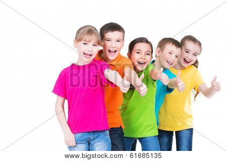 Group of happy kids with thumb up sign in colorful t-shirts standing together -  isolated on white. poster