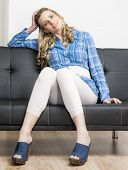 picture of clog  - woman wearing denim clogs sitting on sofa - JPG