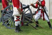 stock photo of revolutionary war  - Select Militiamen Load a Cannon during a Revolutionary War Reenactment - JPG