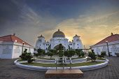 stock photo of malacca  - Malacca Straits Mosque Front Entrance Courtyard in Melaka Malaysia at Sunset - JPG