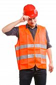 foto of industrial safety  - Young man construction worker builder foreman in orange safety vest and red hard hat isolated on white - JPG