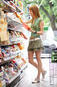 image of grocery store  - red haired beauty while shopping all brandmarks removed - JPG