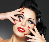 foto of nail-design  - Beautiful fashion woman with red nails - JPG