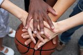 pic of comrades  - hands on a basketball - JPG