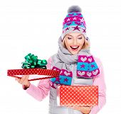 foto of outerwear  - Photo of happy surprised woman with a christmas gift in a winter outerwear  - JPG
