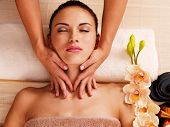 stock photo of low-necked  - Masseur doing massage the neck of an adult woman in the spa salon - JPG