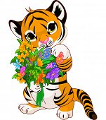 stock photo of tiger cub  - Cute little tiger cub holding a bouquet - JPG