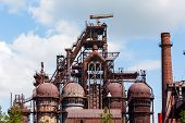 pic of blast-furnace  - building a blast furnace at the steel industry on a background of blue sky - JPG