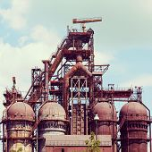 picture of blast-furnace  - building a blast furnace at the steel industry on a background of blue sky - JPG