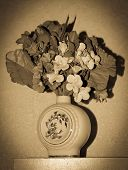 image of yesteryear  - vintage yesteryear bowl of artificial flowers with vignetting - JPG