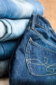 pic of jeans skirt  - In the picture we can see blue jeans and their various parts and components and many details - JPG