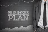 stock photo of benchmarking  - Business strategy concept on blackboard with businessman - JPG