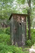 foto of wooden shack  - Old wooden outdoors toilet in summer - JPG