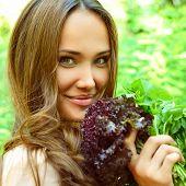 stock photo of slender  - Beautiful slender girl holding healthy fresh greens - JPG