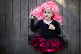 image of antichrist  - Portrait of happy Halloween girl in pink wig looking at camera - JPG