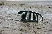 stock photo of pooper  - A chair stuck in the mud at appropriately named  - JPG