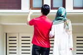 picture of muslim man  - Asian Muslim man and woman choosing house  - JPG