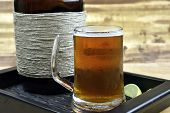foto of growler  - Mug of hand crafted microbrew with growler - JPG