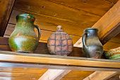 stock photo of canteen  - Two pots and copper canteen on wooden background - JPG