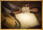 pic of poker hand  - American west background with poker cards and cowboy clothes - JPG