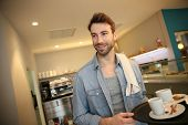 foto of waiter  - Waiter in coffee shop holding service tray - JPG