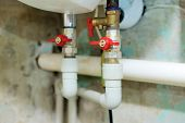 stock photo of valves  - Red valves blocking access to water pipes