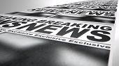 foto of generic  - A long row of fthe front page of a newspaper press run with a generic headline that reads breaking news on an isolated white background - JPG