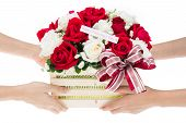 picture of gift basket  - Hand delivers baskets of red and white rose flowers as a gift isolated on white background - JPG