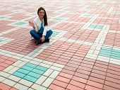 foto of slab  - Image of the young woman sitting on the paving slab  - JPG