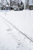picture of driveway  - Over a foot of snow accumulated on a driveway in the suburb - JPG