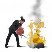 pic of inflamed  - A businessman stressed and pissed burns computers - JPG