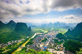 foto of landforms  - Karst Mountain landscape and village on the Li River in rural Guilin - JPG