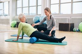 picture of therapist  - Physical therapist working with active senior woman at rehab - JPG