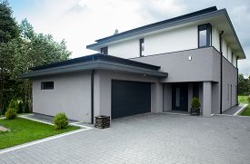 stock photo of enormous  - Contemporary driveway parking of the big modern house - JPG