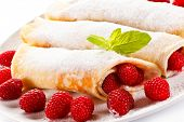 stock photo of crepes  - Crepes with raspberries and cream  - JPG
