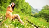 picture of train track  - Fashion photo of a woman sitting on train tracks - JPG