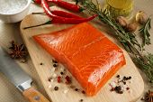 foto of salmon steak  - Salmon steak with herbs on cutting board. Close-up. ** Note: Shallow depth of field - JPG