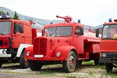 image of fire-station  - The fire engines in the parking lot - JPG