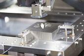 pic of cut  - CNC wire cut machine cutting high precision mold parts - JPG